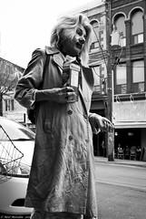 A Disturbing Day. (Neil. Moralee) Tags: road street bw woman white toronto ontario canada black girl monochrome strange hair mono milk costume mac nikon funny comedy sad outdoor candid clown neil stranger mature blond laugh blonde carton clowning raincoat whiteface grotesque scruffy nightgown neilson entertain dishevelled chockolate d7100 moralee neilmoralee canadaneilmoraleenikond7100