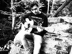 Musician (katieMai) Tags: blackandwhite musician white black photography guitar grainy ph musicvideo blackand alternative