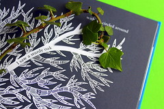 ivy (overthemoon) Tags: blue white black detail green cutout book graphicdesign saturated poem drawing text ivy utata ip ironphotographer tarabooks ramsinghurveti utata:project=ip174 isawapeacockwithafierytail jonathanyamakami