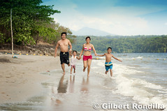 """""""Each day of our lives we make deposits in the memory banks of our children.""""   ~Charles R. Swindoll (Gilbert Rondilla) Tags: family sea beach parenthood water childhood smiling children 50mm parents holding hands waves child father philippines joy daughter mother smiles happiness son running getty filipino pinay filipina sands subicbay subic motherhood fatherhood pinoy sbma bonding gettyimages zambales nikkorlens 50mm18d dungareebeach nikond90 triboa gilbertrondilla gilbertrondillaphotography gettyimagescollection gettyphilippinesfamily"""