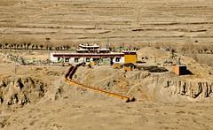 Tomb of Songtsen Gampo with a small Nyingmapa Temple on top. Yarlung-Chongye Valley of Kings, Tibet 2011 (eriktorner) Tags: charity trip king im tomb january visit tibet tibetan kung soir dharma grav mounds emperor yarlung burialmounds 2011 valleyofkings trisong gravar trisongdetsen songtsengampo individuellmnniskohjlp chongye hjlptillsjlvhjlp medmnsklighet imsoir eriktrner imsbildarkiv swedishorganisationforindividualrelief kungarnasdal yarlungdynasty tibetanempire qonggyai