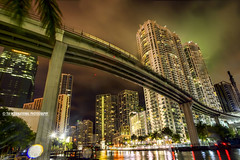 Raindrops on the Riverwalk (TIA International Photography) Tags: city bridge urban cloud storm reflection tree tower home wet water rain architecture tia river landscape real office spring downtown cityscape estate florida cloudy miami district centre central overpass overcast wells center icon palm business international condo rainy commercial transportation april thunderstorm splash residence f