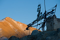 buddhist prayer flags in Leh at sunset with dramatic sky. Ladakh, India. (kampee_p) Tags: old travel sunset sky cliff cloud india mountain building history tourism monument nature rock architecture asian outdoors temple anc