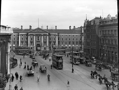 All of early 20th century transport is here (National Library of Ireland on The Commons) Tags: road city ireland horses urban dublin building bus cars cycling foto post fineart trinitycollege tram irland bicycles stadt trucks 20thcentury trams carts verkehr eason automobiles dublino irlanda bovril glassnegative 1632 collegegreen schienen damestreet inchicore leinster bankofireland motorcars scottishprovident swanneck edmundburke henrygrattan nationallibraryofireland sunlightsoap strasenbahn clochehats archdairy easonson easoncollection tram162 keatinges tram230