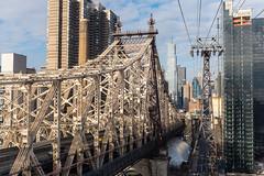 Queensboro (Empty Quarter) Tags: new york city nyc bridge ny building car architecture river island cityscape fuji manhattan steel tram cable roosevelt east midtown fujifilm queensboro truss x100s