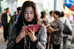 Checking (3)... (anthonyleungkc) Tags: street mobile lady hongkong candid olympus snap f18 45mm checking omd texting lightroom m43 mft mzd em5 microfourthirds mzuikodigital