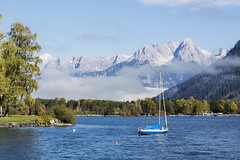 A Boat On The Lake, Zell Am See, Austria (violinconcertono3) Tags: trees lake snow mountains alps tourism water beautiful clouds forest landscape austria boat relaxing bluesky zellamsee cruiser tranquil pinzgau salzburgerland zellersee touristlocation