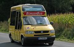 VW Transporter village bus (Schwanzus_Longus) Tags: city red bus yellow vw truck germany volkswagen samba village panel box german transit micro vehicle van standard bully kombi transporter t4 bulli redyellow hude microvan