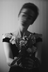 Beauty In Distress (Kimera~) Tags: flowers roses portrait blackandwhite beautiful spring pretty portraitphotography blackandwhiteportrait 50mmlens indoorportrait rosepedals