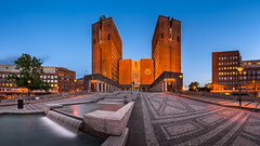 Panorama of Oslo City Hall and Fridtjof Nansens Plass in the Evening, Oslo, Norway (ansharphoto) Tags: city travel blue urban house building brick tower clock tourism oslo norway skyline architecture modern night facade dark square lights evening town hall twilight europe european cityscape exterior dusk cityhall capital landmark illuminated historic norwegian government townhall nordic scandinavia northern scandinavian radhuset guildhall radhus plass destinations administrative fridtjof nansens gildhall