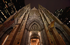 St Patrick's Cathedral (Mark Liddell) Tags: door new york city nyc newyorkcity ny newyork church saint st parish architecture night lens us catholic exterior unitedstates angle cathedral roman manhattan seat low gothic wide stpatrickscathedral dramatic arches landmark midtown doorway neo patricks fifthavenue neogothic avenue 5th ultra atmospheric carvings fifth lowangle archbishop thecathedralofstpatrick