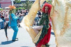 Wings and a Well Dressed Photographer (UrbanphotoZ) Tags: nyc newyorkcity woman ny newyork seaweed brooklyn hair coneyisland gold wings photographer tail redhead curly mermaidparade spectators headband tangled coneyislandmermaidparade turquoisesuit