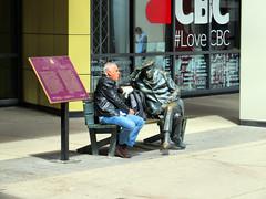 Lunch with a friend (duaneschermerhorn) Tags: street people man art statue bench lunch person candid streetphotography sidewalk publicart
