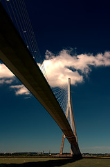 the majestic Pont de Normandie arches of the River Seine on a glorious summer afternoon, Normandy, France (grumpybaldprof) Tags: ocean road bridge summer sky france lines rock clouds contrast river concrete amazing colours afternoon traffic piers angles bluesky textures cables browns huge normandie honfleur normandy hdr impressive patters altantic riverseine normanfoster seine laseine pontdenormandie longestuntil2004 bridgeofnormandycablestayed cablestayedroadbridge lehavre michelvirlogeux