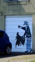 saddle up (byronv2) Tags: burntisland fife coast coastal summer sun sunny sunlight sunshine scotland firthofforth rnbfirthofforth rnbforth forth river riverforth sea northsea cowboy art graffiti streetart garage door garagedoor
