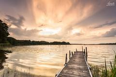 Kieler Woche Wetter am Westensee (Luziferian) Tags: sunset summer sky lake nature water weather backlight clouds landscape mood outdoor jetty atmosphere rays landschaft beams kiel schleswigholstein westensee