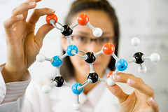 female-scientist-holding-molecule-ThinkstockPhotos (sarahmepstein) Tags: thinkstock scientist stem woman molecule smart innovation innovative scientific