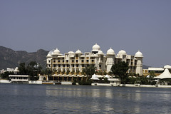 The Leela Palace hotel in Udaipur with its lake front location (Ashish A) Tags: sky plants india lake plant water architecture canon hotel asia bluewater bluesky dslr domes canondslr digitalslr rajasthan udaipur canoncamera luxuryhotel waterbody leelapalacehotel canoneos50d lakeinudaipur hotelinudaipur