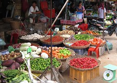 fruit and veg (mistdog) Tags: cambodia market baskets siemreap angkor chillies