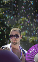 Bubble Background, CAYA Pride Foreground (gherringer) Tags: party summer canada sunglasses vancouver fun happy bc purple bright bokeh britishcolumbia bubbles august pride parade colourful telus caya 2013