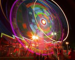 IMG_4009 (Mary Susan Smith) Tags: longexposure motion lights amusement movement ride nightshot fair superhero amusementpark colourful alibaba countryfair bigmomma cy2 challengeyouwinner cychallengewinner thechallengefactory tcfwinner tcfultimategrind herowinner ultraherowinner thepinnaclehof storybookwinner gamex2sweepwinner pregamewinner gamesweepwinner navanfair2013 tphofweek231