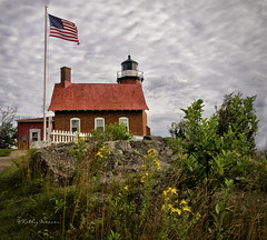Eagle Harbor Lighthouse (kweaver2) Tags: sky lighthouse lake building water architecture clouds landscape photography flag greatlakes lakesuperior fineartphotography eagleharbor kathyweaver