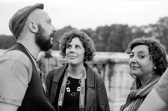 3 little friends (Un ragazzo chiamato Bi) Tags: street portrait white black roma film analog 50mm kodak tmax olympus 100 om bianco zuiko nero f12 pellicola om2n