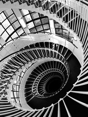 Black and White (martinturner) Tags: uk windows light england white black london fall glass lines spiral hotel inn dynamic falling staircase tall void stark premier leading arcs concentric oval bold martinturner