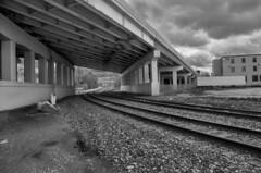Down by the Tracks (Garrett Hoppes) Tags: travel bridge urban blackandwhite bw monochrome train landscape downtown cityscape pentax traintracks tracks grandrapids gr grandrapidsmi urbanconstruction pentaxk5