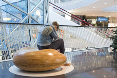 Alone (Igor Voller) Tags: wood glass girl stairs reflections mall shopping germany bench wooden sitting frankfurt escalator glossy tiles shops bannister zeil