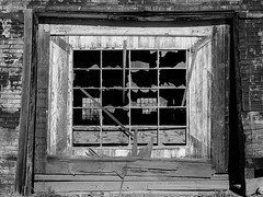 shattered dreams (what's_the_frequency) Tags: wood old blackandwhite bw broken window blackwhite desert plateau empty grain nails highdesert frame dreams ghosttown shattered 95 desolate barren 18200 desolation route95 goldfield miningtown us95 highway95 sigma18200 shattereddreams esmeraldacounty d5100 nevadausroute95