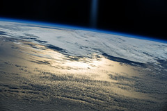 Sunlight Above, Sunlight Below, processed 1 (sjrankin) Tags: ocean clouds glare edited nasa rays iss sunglint earthslimb 26january2015 iss042 iss042e154760