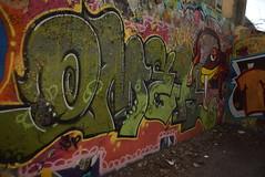 OMEK (TheGraffitiHunters) Tags: street new red white fish black green art yellow wall river graffiti colorful paint walk cement brunswick spray legal omek