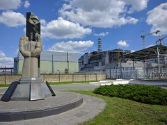 Chernobyl nuclear power plant and monument (justinvandyke) Tags: monument radiation nuclear ukraine disaster soviet sarcophagus biohazard chernobyl postapocalyptic nuclearpowerplant nuclearreactor exclusionzone nucleardisaster