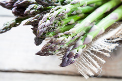 Bunch of fresh green asparagus spears on the table (victoria.kondysenko) Tags: new food green closeup menu season cuisine wooden spring raw spears rustic seasonal vegetable whole asparagus crop meal tips vegetarian bunch string diet bundle agricultural nutritious ingredient
