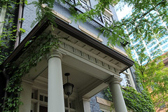 Doric Porch  Columbus, Ohio (Pythaglio) Tags: blue trees building brick stone modern vines painted columns entrance structure doorway porch classical entry neoclassical rowhouse 2007 doric transom capitals revival pilaster entablature facsimile lintels sidelights trabeated triglyphs