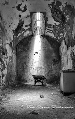 solitude (toddrogers84) Tags: travel urban philadelphia architecture clouds buildings landscape bars gates decay bricks oldbuildings haunted spirits prison daytime alcapone hauntings fallingapart sanitarium prisoncells easternstatepenitantuary