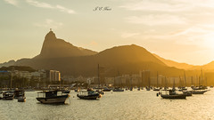 Sunshine in Guanabara Bay (Jos Eduardo Nucci) Tags: winter sunset brazil sky cloud sunlight mountains color beach nature silhouette riodejaneiro season landscape boats photography golden evening nikon outdoor christtheredeemer corcovado solstice layers rays botafogo olympicgames baadeguanabara guanabarabay 2016 cosmevelho enseadadebotafogo wondersoftheworld wonderfulcity joseduardonucci