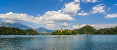 Bled Panorama (Tom Mrazek) Tags: summer sky sun lake abstract mountains castle art nature colors clouds rural landscape vivid slovenia bled
