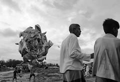 Flying shark (Shadman241091) Tags: shark balloon seller men people beach bnw street chittagong bangladesh canon