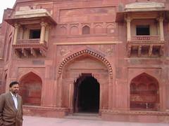 India. Mogul architecture at its best. The abandoned Mogul  or Mughal Fatehpur Sikri Palace near Agra. (denisbin) Tags: indian palace moghul fatepursikri fatepursikripalace mogul mughal man handsomeman guide beardedman hairyman balcony redsandstone