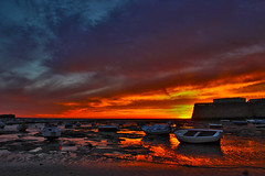 Fuego (Celiamonkeys) Tags: light sunset red sky orange sun beautiful clouds reflections boats atardecer fire photography rojo shapes playa cielo nubes cadiz puestadesol fuego formas incredible barcas naranja lacaleta precioso