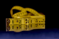 Taped! (BGDL) Tags: reflections dof tape measure tabletop tapemeasure macromonday 7daysofshooting nikond7000 bgdl nikkor50mm118g elementsorganizer11 week44order