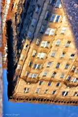 Anywhere but Up (Convicted Melon) Tags: street city light shadow sun abstract color reflection building art philadelphia water architecture canon puddle 50mm spring dof bokeh fineart line utata nik philly shape lightroom canon50mmf14 2013