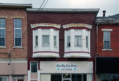 Building - Plain City, OH (Pythaglio) Tags: county city windows ohio food building brick bay rust 11 historic madison commercial storefront curtains pantry plain remodeled