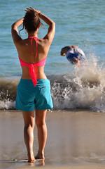 She Scared Him Away! (Ctuna8162) Tags: ocean woman sun man beach sand waikiki oahu playa honolulu coupl japanesehawaii