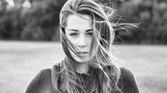 Fall Breeze (kenlastrella) Tags: autumn bw fall girl canon hair 50mm winnipeg wind manitoba stare breeze 40d