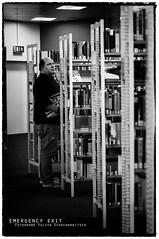 emergency exit 3 (ya.yuli) Tags: man buch 50mm bibliothek sw mann weiss schwarz helmutnewton bcher emergencyexit