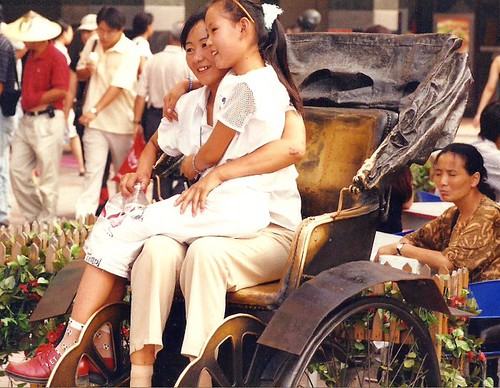 Relaxing on the pedicab Wangfujing