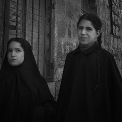 Two young girls in black (Corot Classical Images) Tags: street city travel vacation two portrait people blackandwhite white black girl vintage religious photography israel photo noiretblanc candid jerusalem holy jewish classical judaism blackdiamond meashearim urbanarte classicalphoto